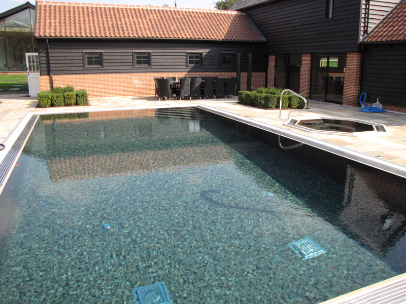 Residential-tiled-outdoor-pool-with-inground-spa